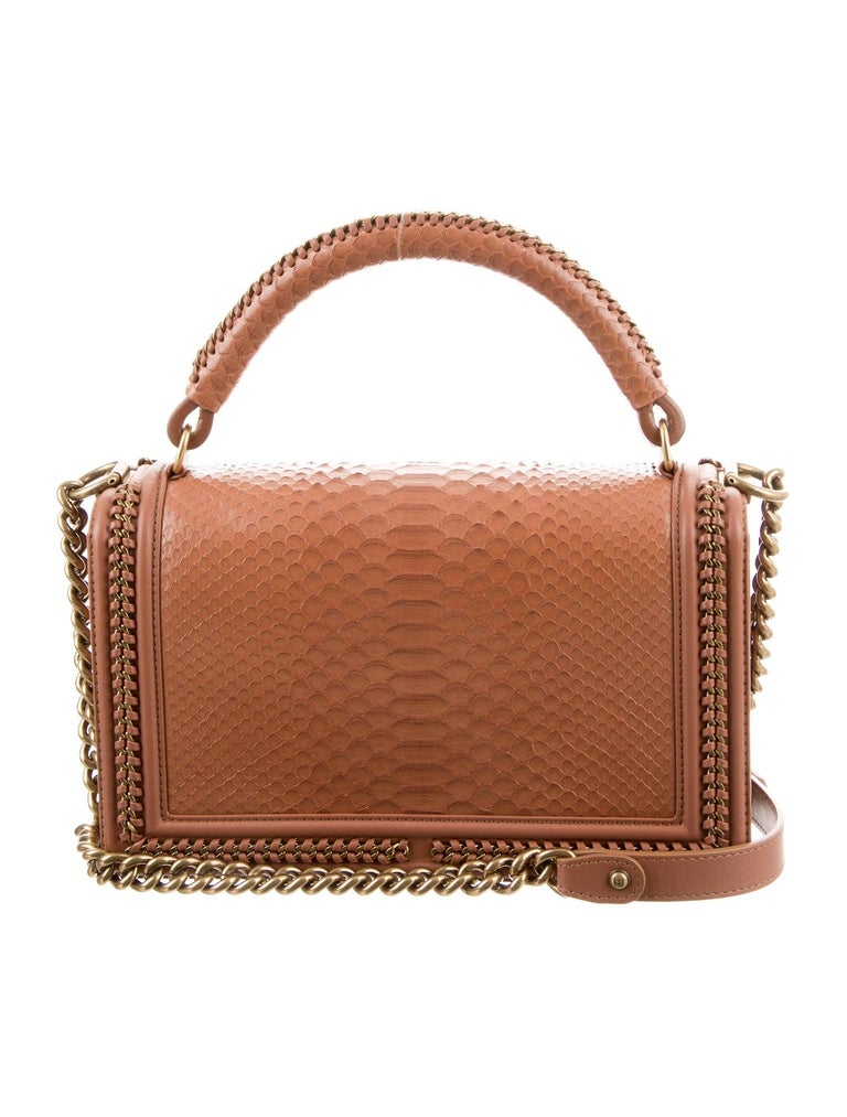 Python  Leather Antiqued gold-tone hardware  Leather lining Date code present Push-lock closure Handle drop 4