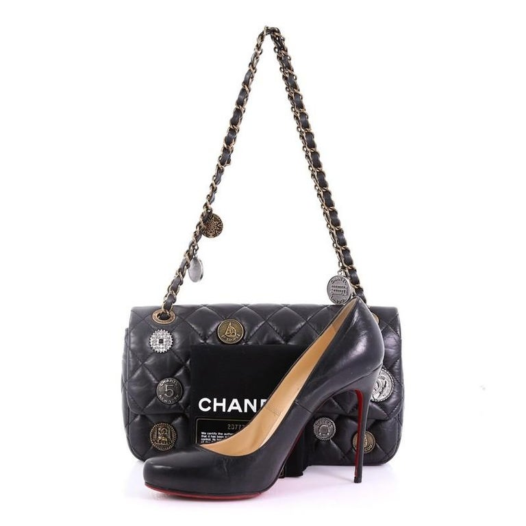 087e3383e205 This Chanel Coin Medallion Flap Bag Quilted Aged Calfskin Medium, crafted  from black quilted aged