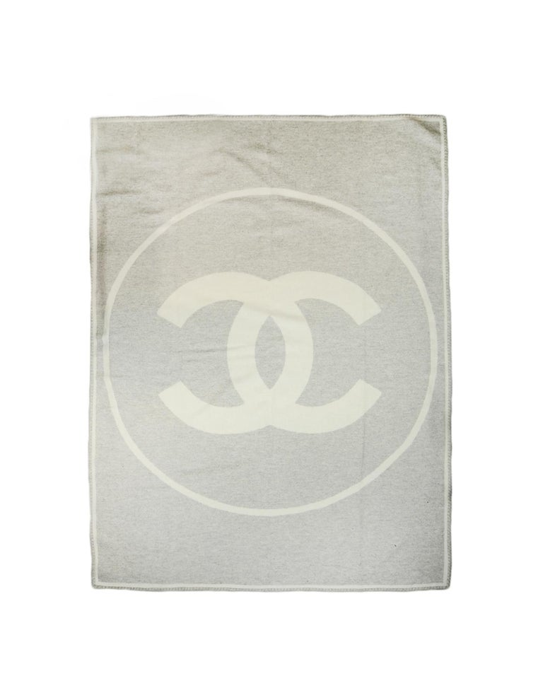 Chanel Cream/Grey Merino Wool & Cashmere CC Throw Blanket  Made In: Great Britain  Year of Production:  Color: Cream, Grey Materials: 90% Wool, 10% Cashmere Overall Condition: Excellent pre-owned condition Includes: Dustbag  Measurements:   72