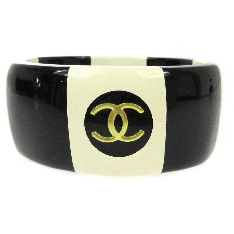 Chanel Cream Ivory Black Gold Stripe Logo Charm Bangle Cuff Bracelet in Box  In Good Condition For Sale In Chicago, IL