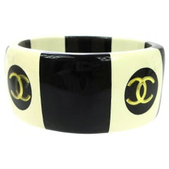 Chanel Cream Ivory Black Gold Stripe Logo Charm Bangle Cuff Bracelet in Box