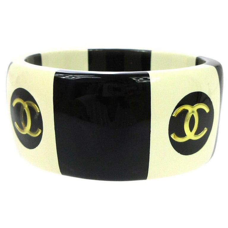 Chanel Cream Ivory Black Gold Stripe Logo Charm Bangle Cuff Bracelet in Box  For Sale