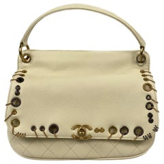 CHANEL Cream/ Ivory Caviar Quilted Grommet Embellished Piercing Flap Bag