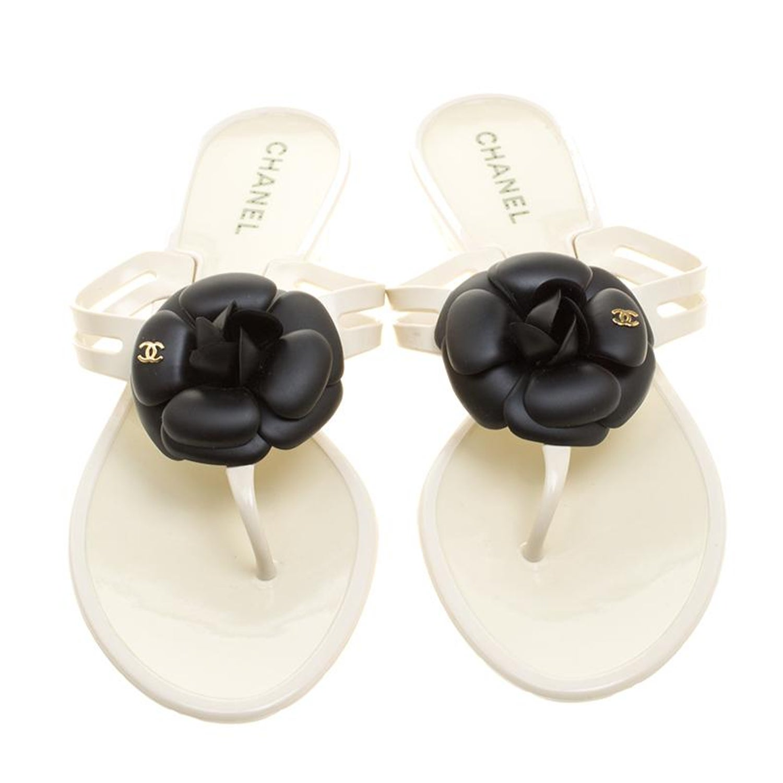 748c685cc7f Chanel Cream Jelly CC Camellia Flat Sandals Size 41 at 1stdibs
