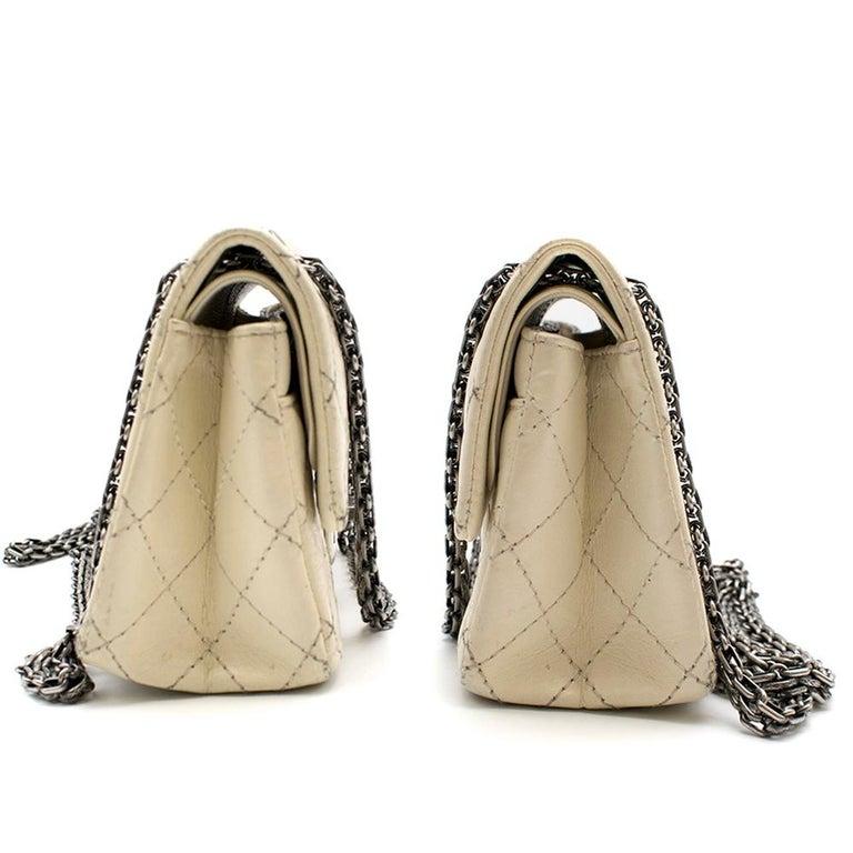 Chanel Cream Lambskin Mini Reissue 2.55 Bag  mini cream, double flap shoulder bag, Aged leather 'Mademoiselle' twist-lock clasp palladium hardware,  Features one back pocket, Features three interior pockets, Chain strap,  Lightweight  Dust bag