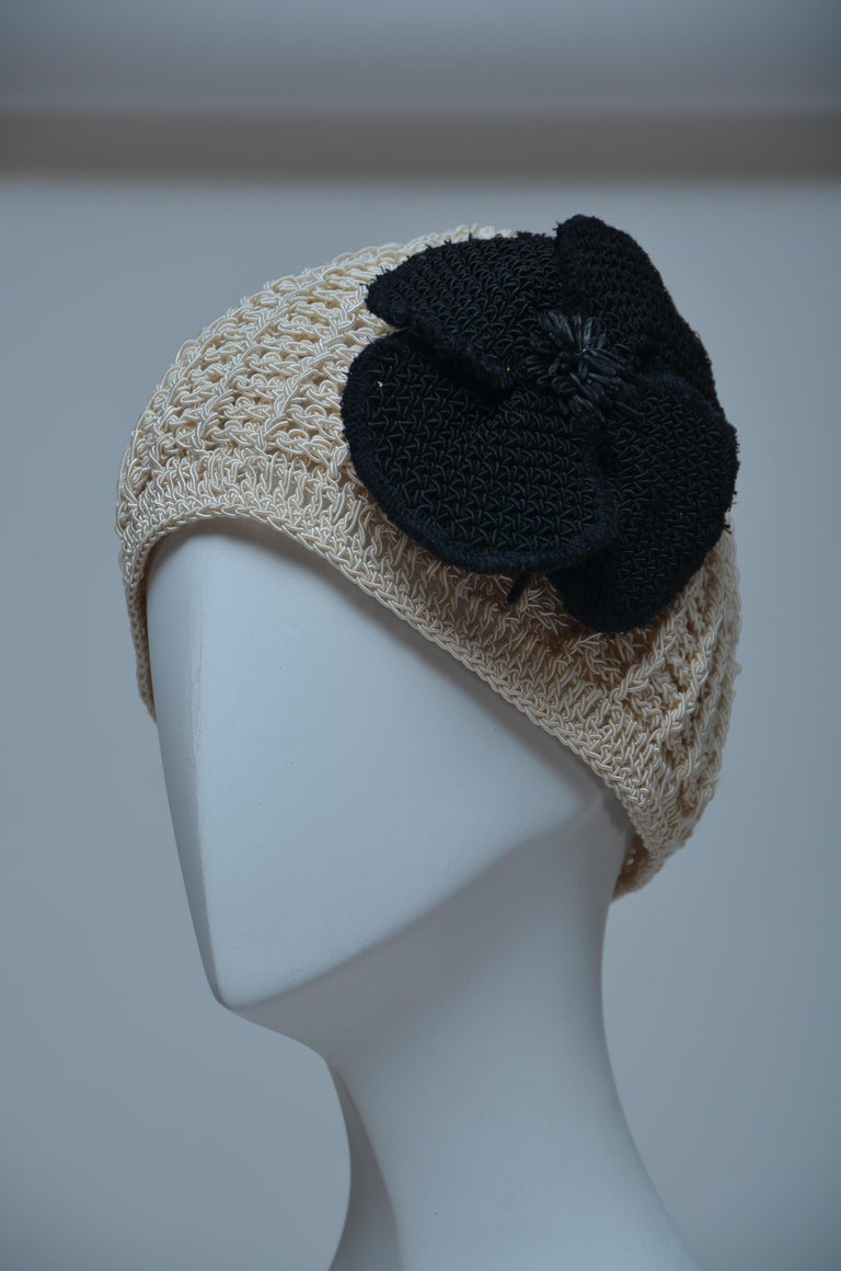 CHANEL Crochet Camellia Beanie. Very rare and impossible to find. Excellent condition Looks unworn. Large crochet black camellia can be removed   FINAL SALE.