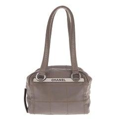 Chanel cube handbag in grey caviar leather in very good condition!