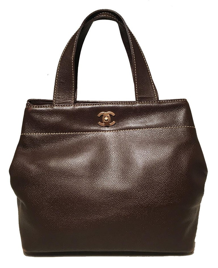 Chanel Dark Brown Caviar Top Handle Shoulder Bag Tote in excellent condition. Brown caviar leather trimmed with matte gold hardware and cream topstitching. removable matching caviar leather shoulder strap. Top twisting CC logo closure opens to a