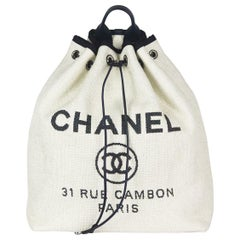 Chanel Deauville Leather Trimmed Raffia Backpack