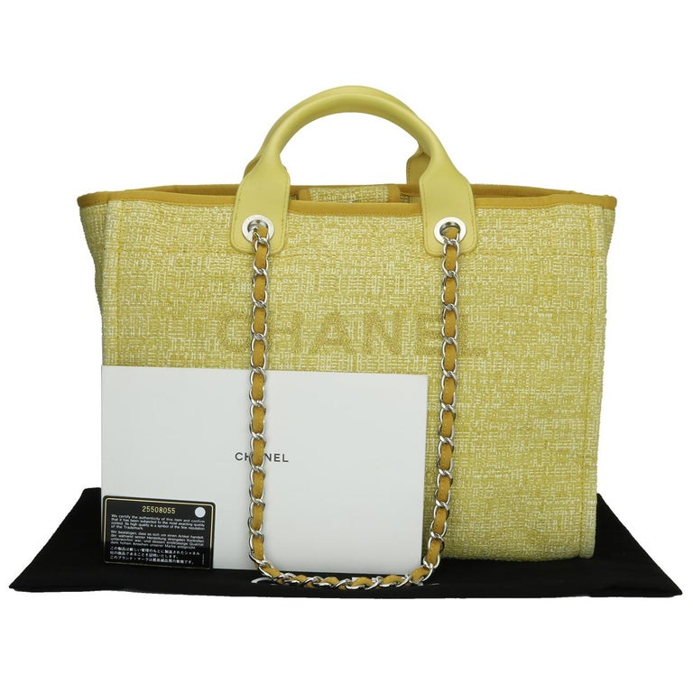 CHANEL Deauville Tote Large Yellow Canvas with Light Gold Hardware 2018.  This bag is in excellent condition.  Exterior Condition: Excellent condition, corners show light signs of wear, outside of the bag shows very minor signs of wear.  Interior