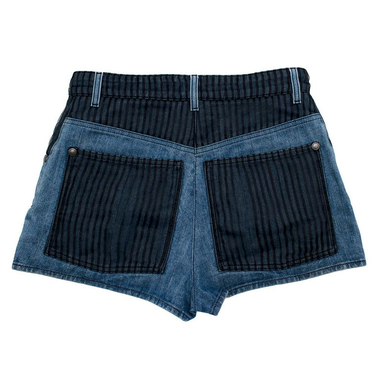 Chanel Denim Shorts with Striped Tulle Overlay  - striped tulle placements on the pockets for contrast detail - High waisted shorts - Mid wash denim  - Gunmetal grey zip fastening at with CC on the zip clasp - Can be worn with a belt - Button