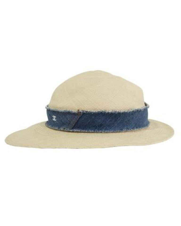 Stylishly beat the summer heat with Chanel's straw hat. It comes in a classic light beige color adorned by denim at the base, featuring the brand's CC logo at the front making it a staple addition to your accessories collection. Pair with a summer