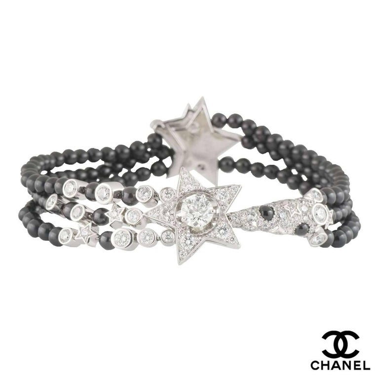 A beautiful 18k white gold diamond and spinel Chanel bracelet from the Comete collection. The bracelet comprises of a star motif set to the centre with a 0.45ct round brilliant cut diamond in a 4 claw setting in the middle of the star, F colour and