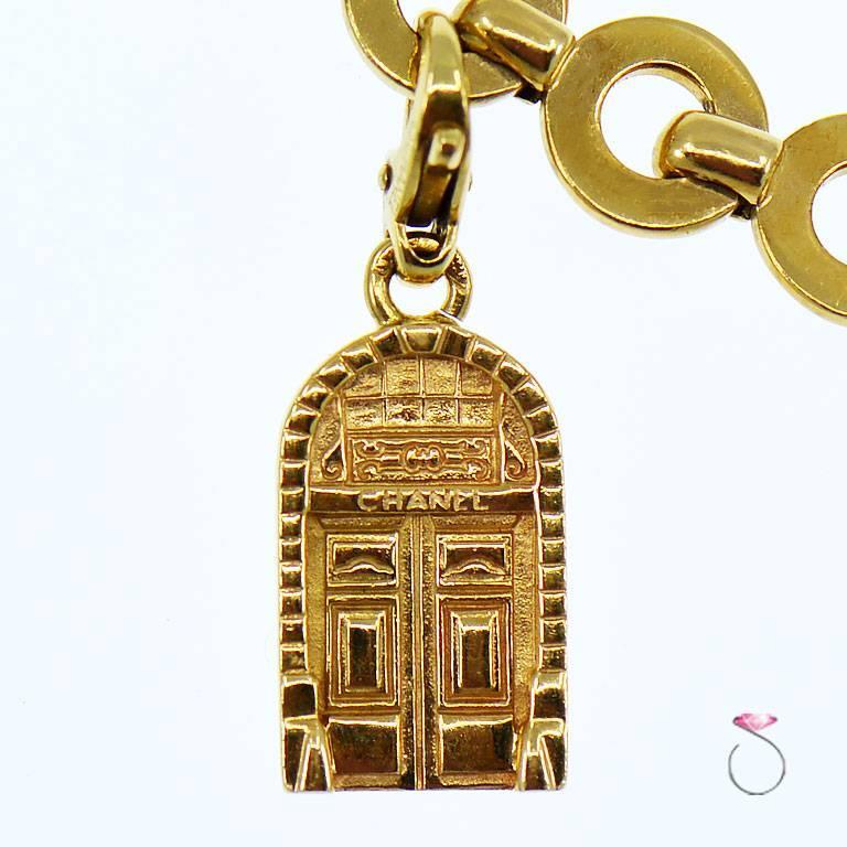 Contemporary Chanel Diamond Charm Bracelet, Five Charms, 18 Karat For Sale