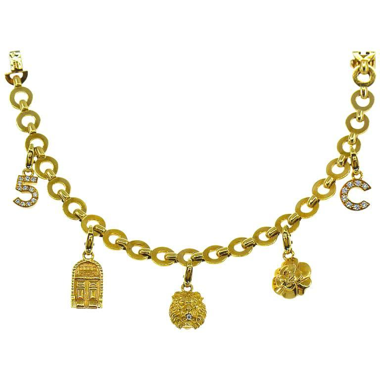 Chanel Diamond Charm Bracelet, Five Charms, 18 Karat For Sale