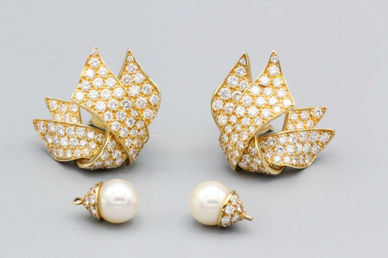 Chic diamond and 18K gold earrings with a removable pearl, by Chanel.   The pearl can be added in the nightime for a more striking effect. They feature high grade round brilliant cut diamonds of approx. 5-6 carats, the pearl measures 9 mm in