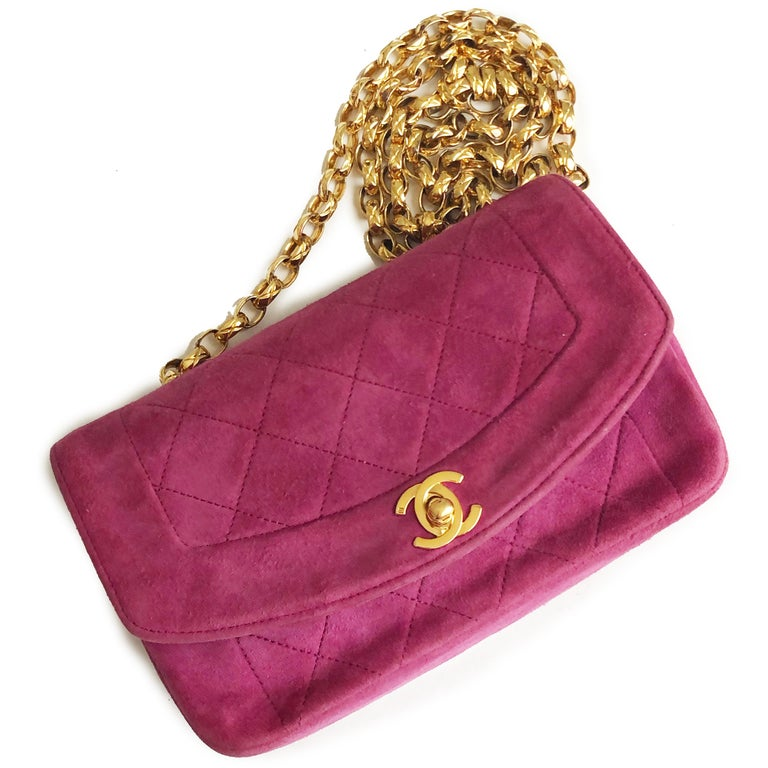 Authentic, preowned, vintage 90s Chanel 'Diana' Flap Bag with removable gold chain.  Made from pink suede, it's lined in suede and leather with one small zip pocket.  A classic bag in a hard to find color that's perfect for summer.  Preowned/vintage