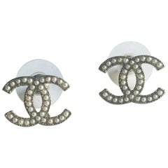 CHANEL Double C Stud Earrings in Gilt Metal and Pearls