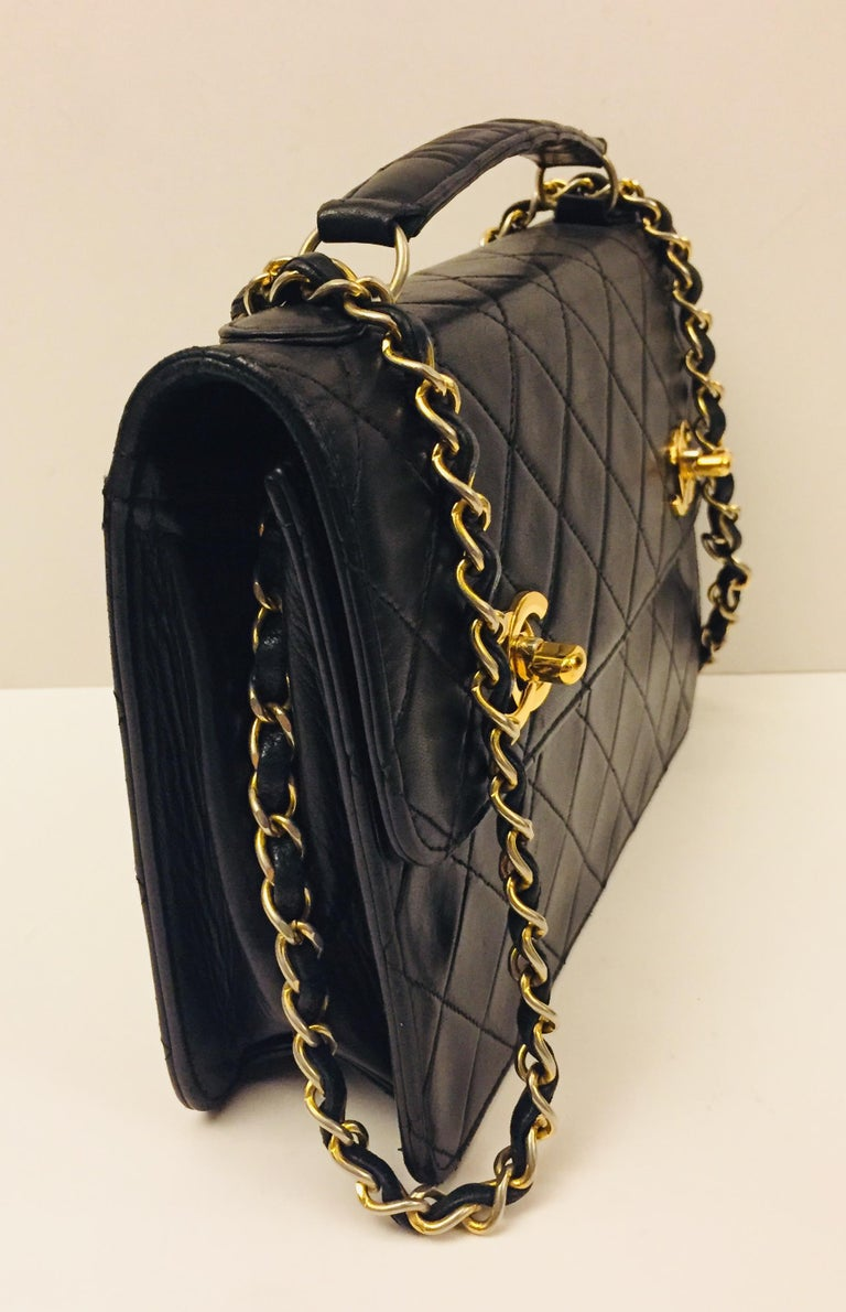"- Vintage Chanel 90s black lambskin double ""CC"" shoulder bag.  It is a rare gem!   - measurements: 23cm x 16cm x 5 cm. 40cm drop."