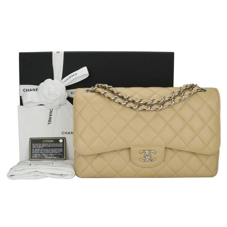 Authentic CHANEL Classic Double Flap Jumbo Bag Beige Clair Caviar with Silver Hardware 2013.  This stunning bag is in mint condition, the bag still holds the original shape and the hardware is still very shiny.  Exterior Condition: Mint condition,