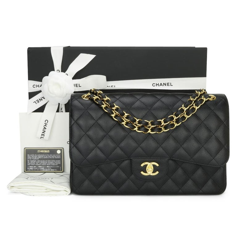 CHANEL Classic Double Flap Jumbo Bag Black Caviar with Gold Hardware 2016.  This stunning bag is in mint condition, the bag still holds its original shape, and the hardware is still very shiny.  - Exterior Condition: Mint condition. Corners show no