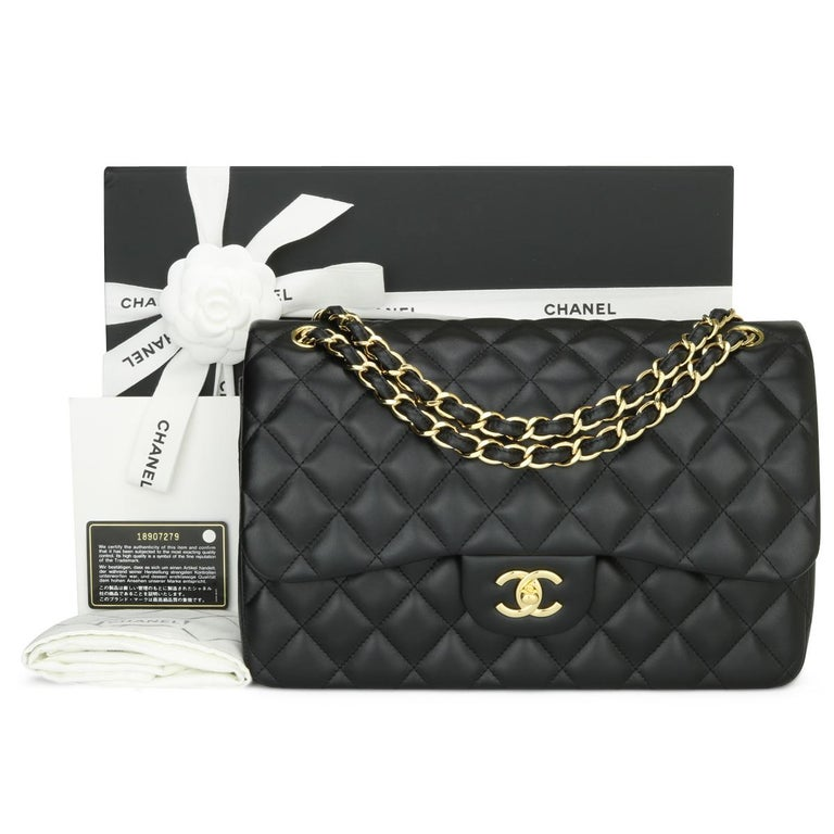 CHANEL Classic Double Flap Jumbo Bag Black Lambskin with Gold Hardware 2014.  This stunning bag is in excellent condition, the bag still holds its original shape, and the hardware is still very shiny. The leather smells fresh as if new.  - Exterior