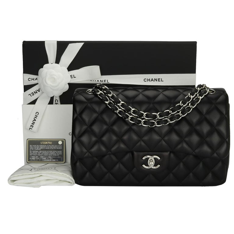 Authentic CHANEL Classic Jumbo Double Flap Bag Black Lambskin with Silver Hardware 2013.  This stunning bag is in excellent-mint condition, the bag still holds its original shape, and the hardware is still very shiny.  Exterior Condition: Mint