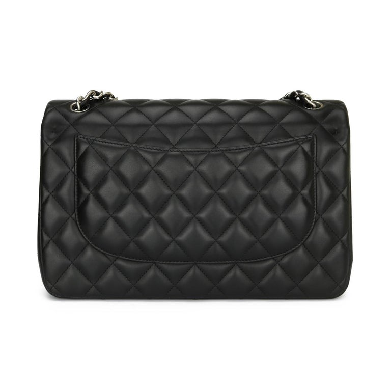 Authentic CHANEL Classic Double Flap Jumbo Bag Black Lambskin with Silver Hardware 2015.  This stunning bag is in mint condition, the bag still holds its original shape, and the hardware is still very shiny. The leather smells fresh as if new.  -