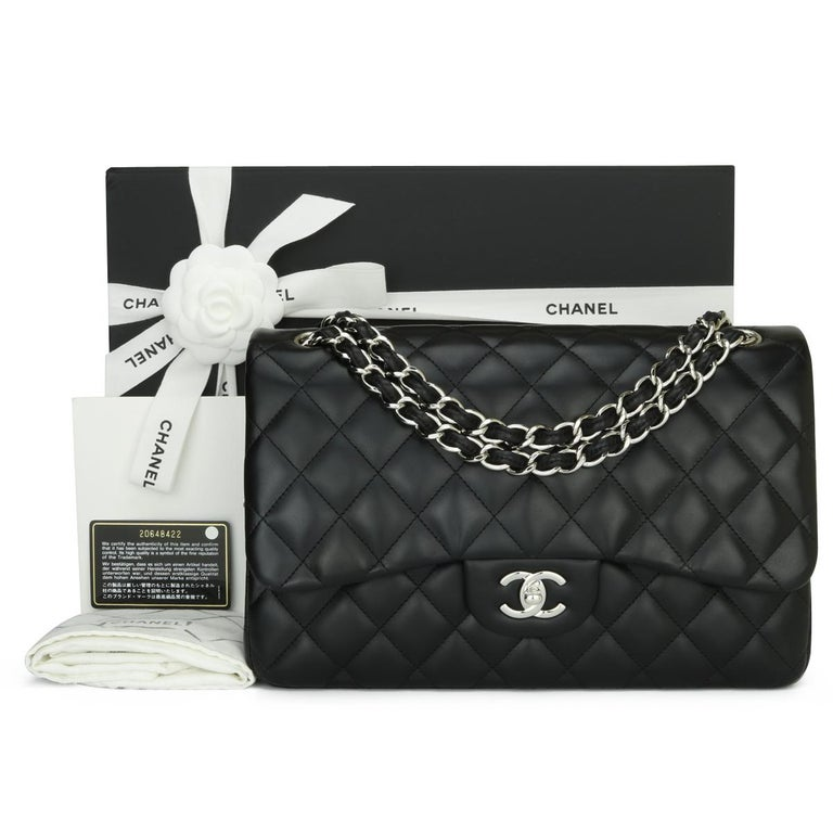 CHANEL Classic Double Flap Jumbo Bag Black Lambskin with Silver Hardware 2015.  This stunning bag is in excellent condition, the bag still holds its original shape, and the hardware is still very shiny.   - Exterior Condition: Excellent condition.