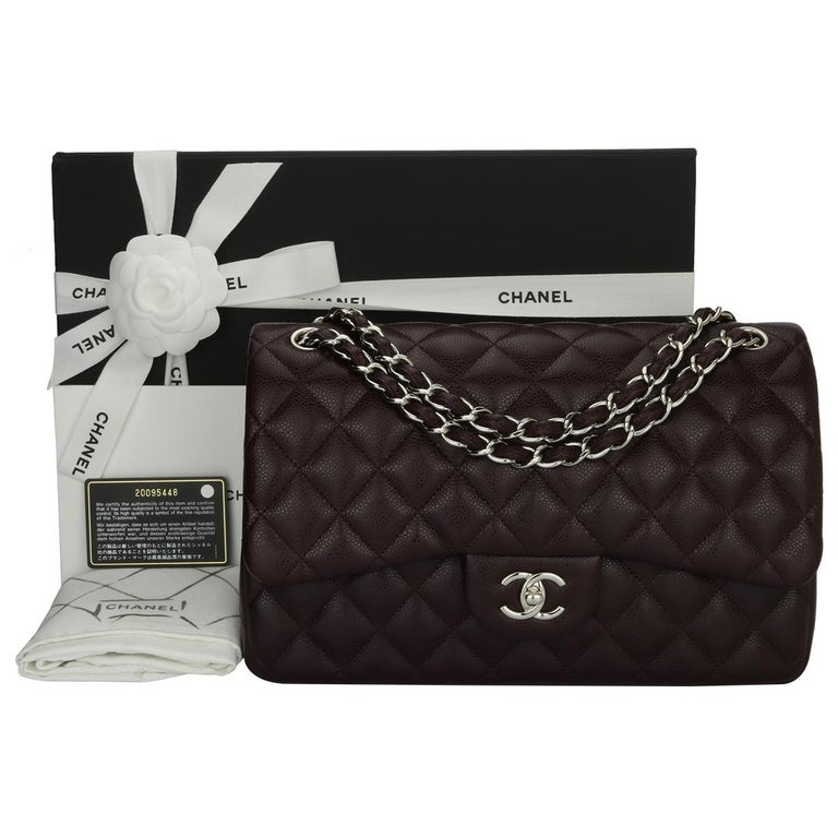 Authentic CHANEL Classic Double Flap Jumbo Bag Dark Burgundy Caviar with Silver Hardware 2015.  This stunning bag is in pristine condition, the bag still holds its original shape, and the hardware is still very shiny. The leather smells fresh as if