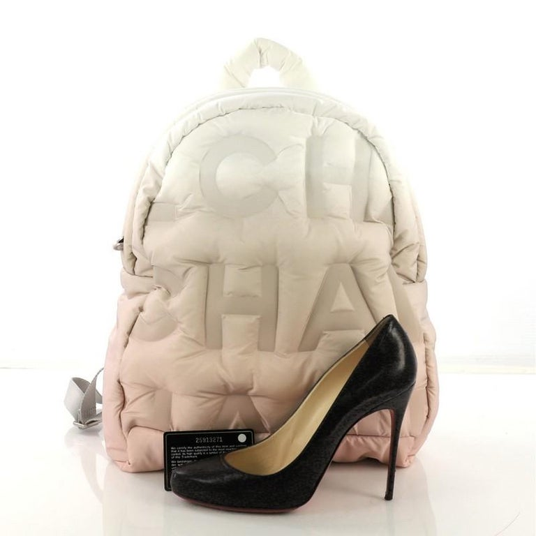cb803531fe4211 This Chanel Doudoune Backpack Embossed Nylon Medium, crafted from pink and  white embossed nylon,