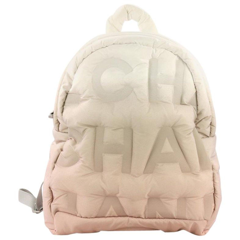 6a9c90f9d943 Chanel Doudoune Backpack Embossed Nylon Medium at 1stdibs