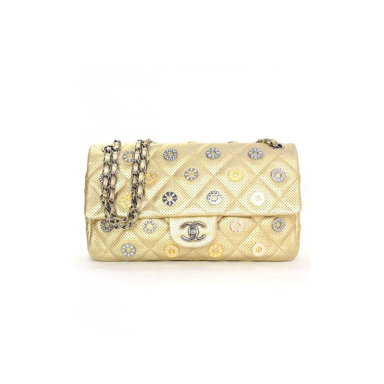Chanel Dubai Resort Swarovski Studded Classic Charm Reissue Flap  Year: 2015 Silver hardware Gold lambskin perforated leather Swarovski charm crystals details Classic interwoven chain Reissue chain strap CC turn lock closure Zippered interior and