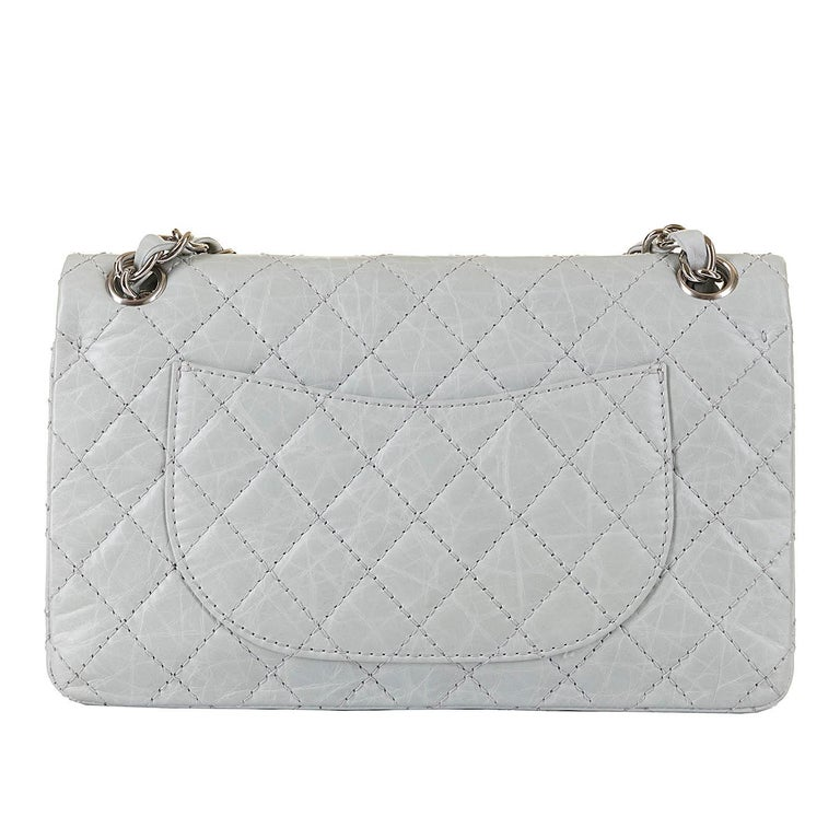 Gorgeous colour, Pristine condition, this very chic Chanel medium, double-flap, Sac Timeless Bag, is finished in 'Eau-de-Nil' quilted leather, accented with silver hardware, and is in pristine, 'New & Unused' condition, throughout. A rare colour