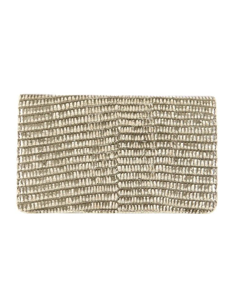 Chanel Exotic Lizard Skin Leather 2.55 Silver Envelope Evening Wallet Clutch Bag  Lizard Silver tone hardware Leather lining Turnlock closure Date code present Made in Italy Features eight interior card slots, four bill compartments and interior zip