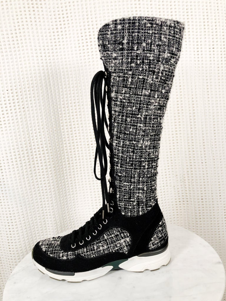 Fabulous Chanel black/white knee-high black and white Fantasy tweed lace-up sneakers.