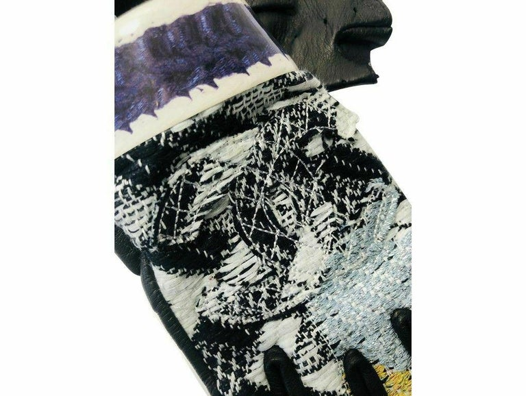 These beautiful fingerless gloves by Chanel are just wonderful.  Purchased and stored – never used. These gloves have a chic, timeless style only from Chanel.  Chanel  ACCESSORIES Dust cover  COLOUR Black, Blue, Grey, White  CONDITION As new and