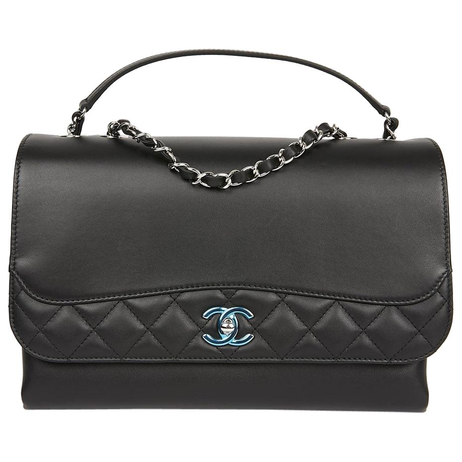 CHANEL Flap Bag in Black Smooth and Quilted Leather