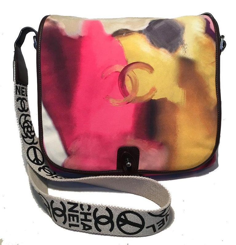 Chanel Flower Power Messenger Multicolor Nubuck Crossbody Shoulder Bag in excellent condition. Painted nubuck exterior in pinks, white, yellows, grays, and purples trimmed with brown leather edges and silver hardware. Woven canvas adjustable