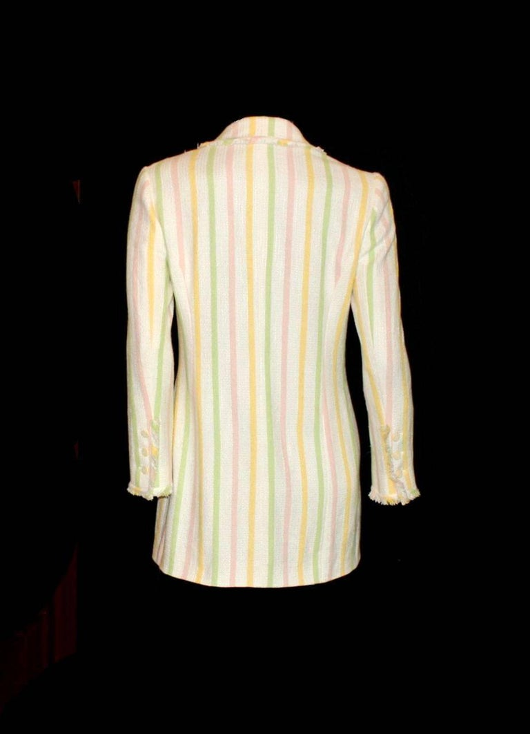Beautiful CHANEL fantasy tweed jacket  A true CHANEL signature item that will last you for many years Beautiful pastel striped tweed fabric Matching clover tweed brooch Fringe trimming Jacket closes with CC logo buttons Sleeves with CC logo buttons,