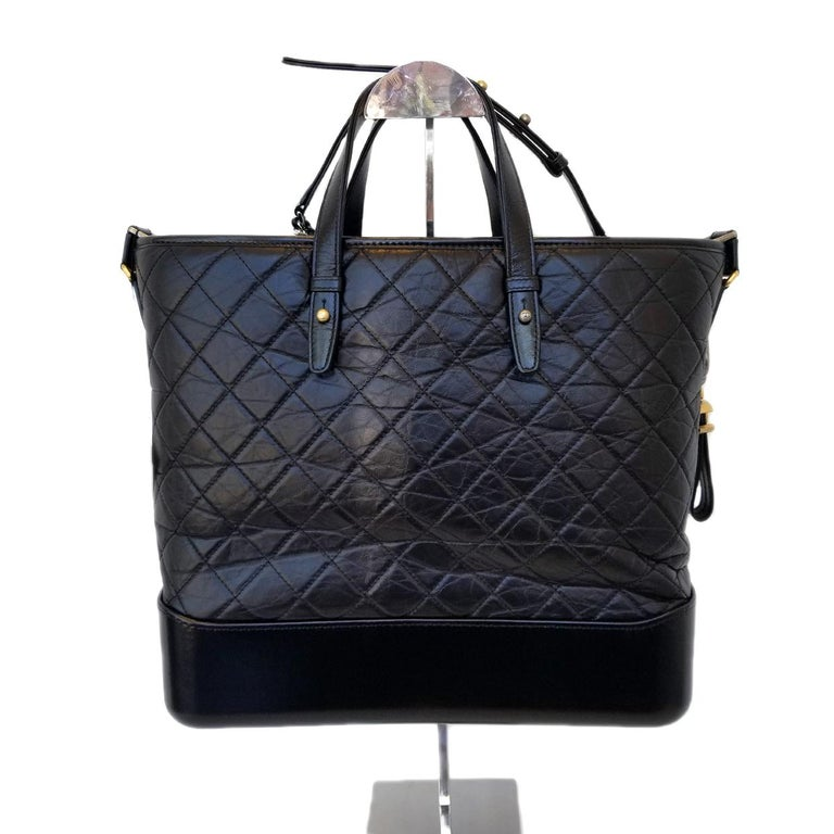 Brand - Chanel Collection - Gabrielle Estimated Retail - $4,600.00 Style - Hobo Bag Material - Calfskin Leather Color - Black Pattern - Quilted Closure - Zip Hardware Material - Multitonal Model/Date Code - A93823 Comes With - Box, Dustbag, Designer