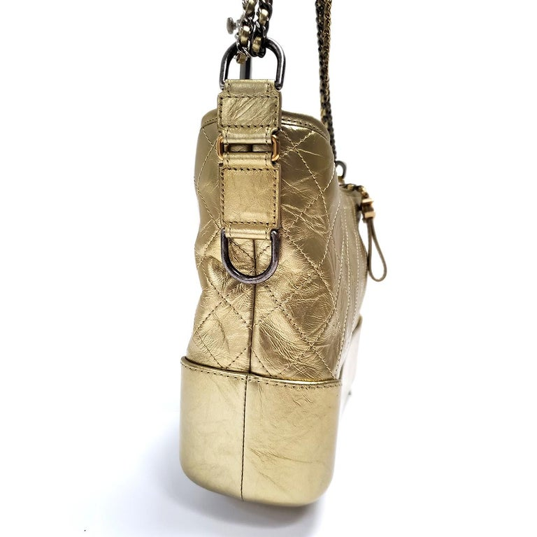 Brand - Chanel Collection - Gabrielle Estimated Retail - $4,500.00 Style - Hand Bag Material - Lambskin Color - Gold Pattern - Quilted Closure - Zip Hardware Material - Goldtone & Silvertone Model/Date Code - 243***08 Comes With - Box, Dustbag,