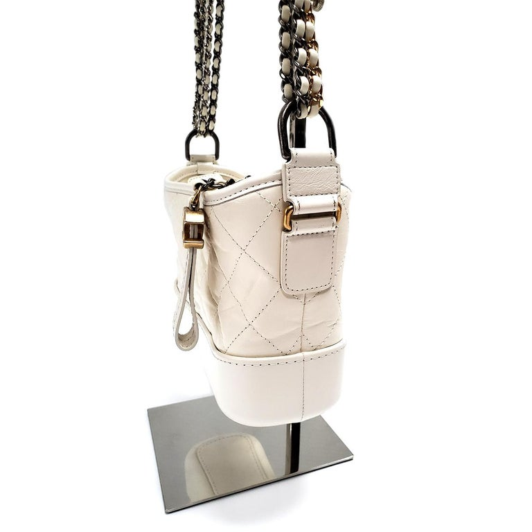Brand - Chanel Collection - Gabrielle Estimated Retail - $3,900.00 Style - Hobo Bag Material - Lambskin Leather Color - Ivory Pattern - Quilted Closure - Zip Hardware Material - Multitone Model/Date Code - 271***36 Comes With - Box, Dustbag Size -