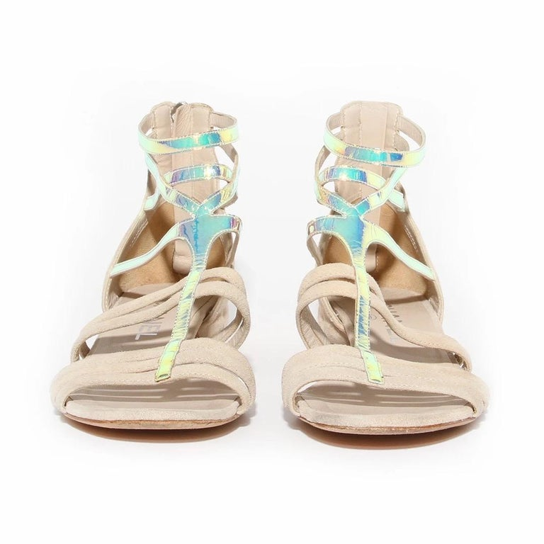 Chanel by Karl Lagerfeld Gladiator Sandal  Spring / Summer 2012 Ready-to-Wear Collection  Made in Italy  Light tan suede  Iridescent foil details on front of sandal  Zipper on back of sandal  Suede leather zipper pull with silver interlocked CC
