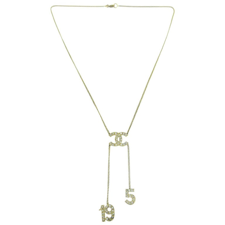 Chanel Gold 5 and CC Charms Drape Lariat Evening Dangle Chain Necklace  For Sale