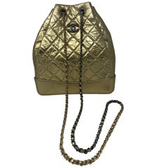 Chanel Gold Backpack or Crossbody Bag