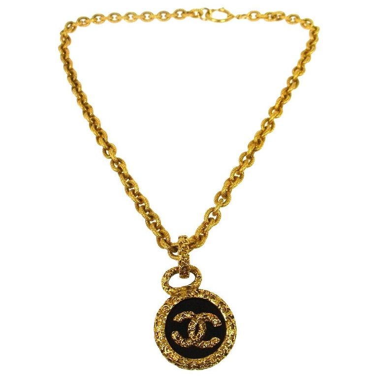 Chanel Gold Black Charm Logo Round Statement Evening Dangle Chain Necklace  For Sale