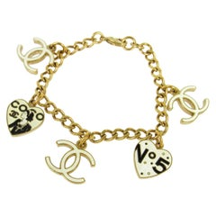 Chanel Gold Black Cream Charms No. 5 CC CoCo Evening Chain Link Bracelet