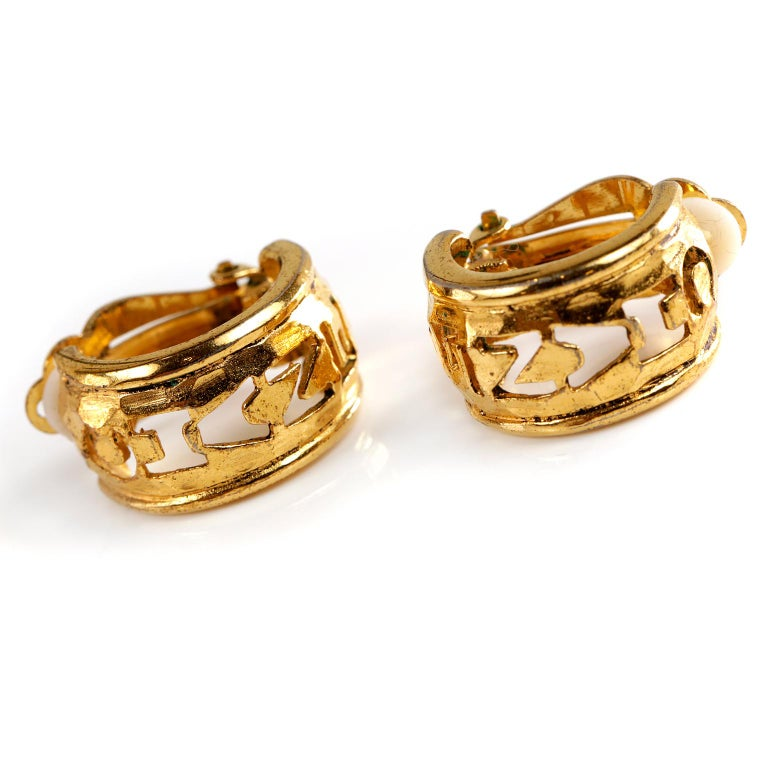 Chanel Gold CHANEL Cutout Clip On Earrings- excellent condition   Gold tone huggy style hoops have CHANEL cut out lettering.  Clip on style.