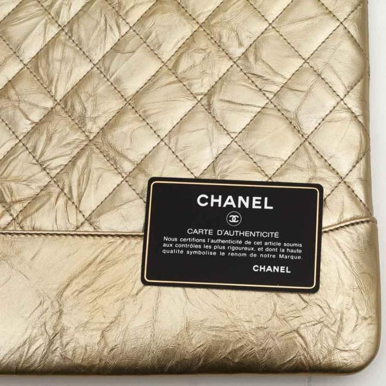 Women's CHANEL Gold Clutch In Aged Leather For Sale